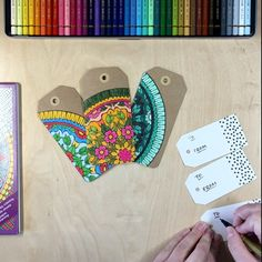 Upcycle your colored pages into beautiful handmade gift tags! Learn how to make these super easy DIY coloring book gift tags!