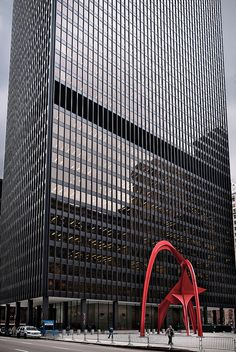 """Flamingo, Kluczynski Federal Building (1974), 230 South Dearborn Street, 45-story modernist skyscraper designed by (Ludwig) Mies van der Rohe (1886–1969) • one of three buildings that make up Federal Center • built on site of Henry Ives Cobb courthouse where Al Capone convicted of tax evasion • """"Less is more,"""" """"God is in the details,"""" famous van der Rohe quotes • 53-foot (16 m) red steel sculpture """"Flamingo"""" (1974) by Alexander Calder, conserved and restored, 1998"""
