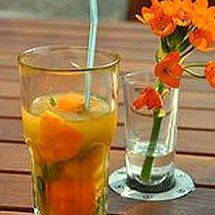 Orange Mint Tea 3 cups water 6 sprigs mint,each 6 inches 1/3 cup sugar OR 1/4 cup honey 2 cups fresh orange juice 1/2 cup fresh lemon juice  Cold water Fresh mint Thinly sliced orange/lemon Boil 3 cups water. Add mint, cover, remove from heat. Steep 15 minutes. Remove mint. Add sugar/honey and stir til dissolved. (May be frozen for later use) Combine orange & lemon juices in 2-qt pitcher. Add mint concentrate & water/ice to fill pitcher. Chill. Serve garnished with mint sprigs…