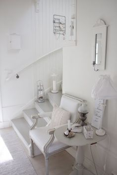 Stunning white entrance hall. I would have a few accent pieces in this room to make it look less bland.   http://www.passionobsession.co.uk