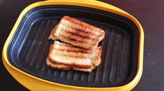 Grilled Cheese Sandwich: Preheat the Rangemate for 4 minutes. Take it out and add a 1/2 tablespoon of butter and let it melt. Put the bread on the grill and let it toast the bread for a minute. Heat it again for 30 more seconds in the microwave. Take it out, add the cheese (2 slices), and fold into a sandwich.