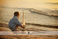 sailboat and boy, beach photography, sunrise beach, sailboat, kid with boat