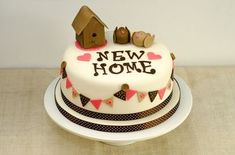 A few weeks ago, one of my work colleagues asked me if I could make her a New Home cake as a gift for friends who were moving into a new home. As I am about to embark on a 5 day intensive cake deco...