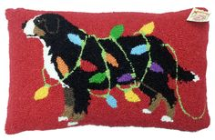 Christmas dog patterns are all the design rage! Discover our collection of dog pillows, this one featuring Bernese Mountain Dog wrapped in Christmas lights.