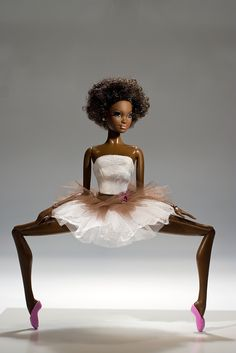 African American Ballerina Barbie doll in doing plie in second position.