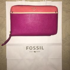"""NWT Fossil clutch Brand new with tags Fossil clutch with tags hot pink/ coral. Gray interior with plenty of pockets! Dimensions 6.5"""" L x 4"""" H. Will ship with Fossil shopping bag Fossil Bags Clutches & Wristlets"""