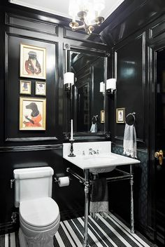 If you've always wanted to paint it black like The Rolling Stones, now is your chance. A small bathroom is a great place to slather the inky hue everywhere and step over to the dark side for a...