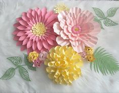 three handcrafted  paper flowers from  Flower Shower (@itstheflowershower) on Instagram ... beautiful pastels ...