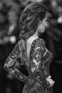 Pretty braid.  Although I would braid it all the way down instead of the weird half ponytail thing.