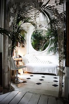 Love the textures of the curtain and plants with all these neutral elements