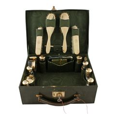 This small antique dark green leather fitted dressing case is available to buy online now. Antique Bedroom Furniture, Antique Vanity, Hair Grips, Manicure Set, Green Leather, Pin Cushions, Glass Jars, Brushes, Bottles