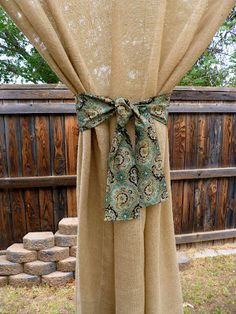 Sweet Tea Sunsets: DIY burlap curtains on the patio  I like this but I might go for the bleached burlap !