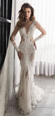 Riki Dalal Wedding Dresses Spring 2019 Glamour Bridal Collection. Embellished lace wedding dress with illusion sleeves. Fitted bridal gown plunging neckline. #weddingdress #weddingdresses #bridalgown #bridal #bridalgowns #weddinggown #bridetobe #weddings #bride #weddinginspiration #dreamdress #fashionista #weddingideas #bridalcollection #bridaldress #fashion #bellethemagazine #ido #dress See more gorgeous wedding gowns by clicking on the photo