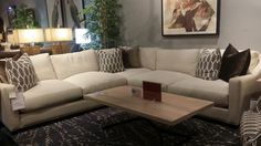 Comfort and style combine to give this gorgeous cream sectional sofa the perfect look and feel for any living room! | Houston TX | Gallery Furniture |