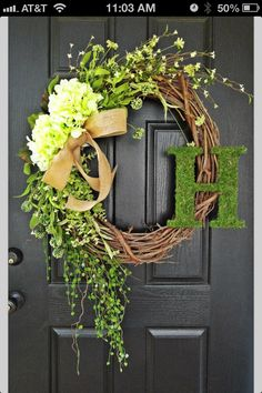 Spring Wreath w/ monogram. I would use a little larger letter in an antique white faux finish.