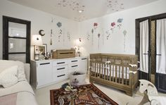 """""""I love the Kalon IoLine crib in Flora's room,"""" Estee says. """"It's so cool and so different, and more cozy than any cribs I'd ever seen."""" """"The stars on the ceiling I did by myself, with a sponge I cut into the shape of a star. I was inspired by a wallpaper I found that was discontinued. It took me less than two hours, and I love how it turned out!"""" The DIY ceiling finds its high-end counterpart with the elephant rug, actually a Hermès mat. """"It was a gift, thank God,"""" Estee says. """"My…"""