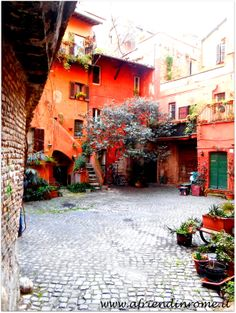 Hidden courtyard from Arco degli Acetari, near Campo dei Fiori.  Learn. Live. Love. Rome. With www.friendinrome.it