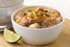 Santa Fe Chicken Enchilada Stew – Warm up with this enchilada-inspired Southwestern stew recipe for dinner, made with chicken, veggies, and beans in a creamy broth, topped with the perfect amount of crunch! Mexican Dishes, Mexican Food Recipes, New Recipes, Crockpot Recipes, Soup Recipes, Chicken Recipes, Cooking Recipes, Favorite Recipes, Easy Recipes
