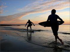 Sunset, skim boarding