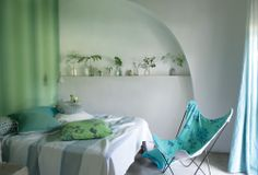 Cool jade greens are the perfect colour for the bedroom. Designers Guild