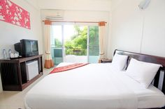 Chiang Rai Morning Dew Lodge Thailand, Asia Ideally located in the prime touristic area of City Center, Morning Dew Lodge promises a relaxing and wonderful visit. The property features a wide range of facilities to make your stay a pleasant experience. To be found at the hotel are free Wi-Fi in all rooms, 24-hour security, daily housekeeping, 24-hour front desk, Wi-Fi in public areas. Each guestroom is elegantly furnished and equipped with handy amenities. The hotel offers var...