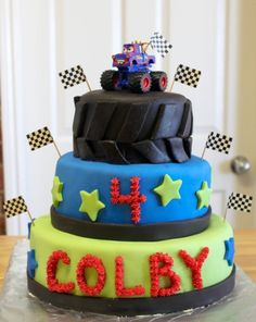 Monster Truck Cake - Monster truck birthday cake for my son's birthday. He chose one of his toy trucks to use as the topper. MMF with buttercream letters & number. My first time covering cakes with fondant. Monster Truck Birthday Cake, Monster Truck Party, Monster Trucks, Toy Trucks, Fondant Cakes, Cupcake Cakes, Mater Cake, Tire Cake, Truck Cakes