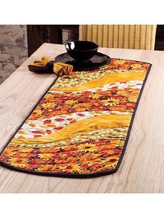 An easy project to whip up! This table runner and place mat pattern is perfect for all those large-scale prints that have been giving you that come-hither look. Quick-to-stitch and super trendy, the finished project makes for a great gift for any s...