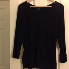 "Express chic weekend top 60% cotton/40% modal black long sleeve top. Weight is between a tee and a lightweight sweatshirt. Banded at end of sleeves and bottom hem. Very comfy. 25"" long, 40"" arm to arm. Express Tops Tees - Long Sleeve"