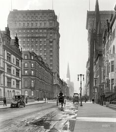 """New York circa 1905. """"St. Regis and Gotham hotels."""" Looking south along Fifth Avenue at East 56th Street, a streetscape glimpsed here from a different angle. On the right, the Gotham rising behind Fifth Avenue Presbyterian Church"""