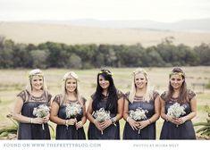 Navy-purple bridesmaids dresses & bouquets | Photography: Moira West, Dresses: G Couture, Flowers:  Saffron