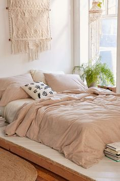 Bohemian bedroom with pink bedding