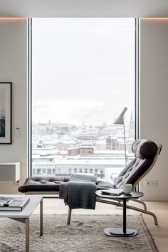 Gorgeous! Recliner in front of a big window.