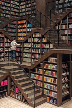 X living completes chongqing zhongshuge bookstore in china with escher-like stairs Library Cafe, Dream Library, Library Books, Library Bedroom, Book Cafe, Beautiful Library, Home Libraries, Public Libraries, Glass Facades