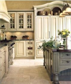 Beautiful kitchen cabinets // contrast between the main cabinets and the island cabinets // in love