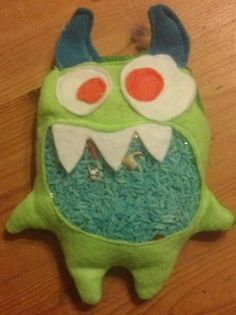 """My Pinterest inspired """"Mr. Get In My Belly"""" homemade I Spy monster! Contains 30 assorted charms & trinkets. Made for my nephew as a Christmas present!! ~Zoa Barker"""