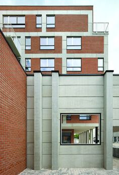 View east from the community hall 'smoking courtyard' to the larger of the two new housing blocks.