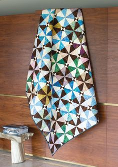 "You won't believe it, but there are no triangles to cut in this batik quilt. Learn how to make 8 triangle-squares at a time using pre-cut 10"" squares."