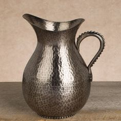 Another new piece from The GG Collection: This Antique Silver Pitcher is hammered metal with a silvery finish that elegantly pours 88 ounces of whatever you fancy, $96.00