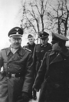Heinrich Himmler in conversation with Theodor Eicke, one of his most trusted generals and father of the concentration camp system, during a visit to the Eastern Front in January 1942. Eicke was killed in Feb 1943 when his light observation airplane was shot down by Russian AA fire between the villages οf Mikhailovka and Artelnoje in the Ukraine.