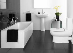 Bathroom. Extraordinary Black And White Interior Bathroom Design Alongside White Corian Square Bathtub And Grey Floor Tile In Addition To White Fiberglass Sitting Water Closet Furthermore Freestanding Vanity Sink Likewise Square Mirror.