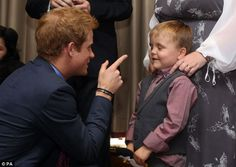 Cheeky: Ahead of the ceremony the youngster said he would say to the royal: 'I'm glad you've got your clothes on Prince Harry!' But Prince Harry wagged his finger and light-heartedly admonished the little boy last night