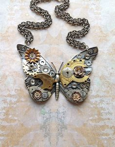 Steampunk Butterfly Necklace - Custom Design Silver Butterfly with Watch Gears Brass Flowers and Jewels from bionicunicorn on Etsy. Saved to Jewelry. Steampunk Cosplay, Arte Steampunk, Style Steampunk, Steampunk Design, Steampunk Wedding, Steampunk Fashion, Fashion Goth, Steampunk Watch, Steam Punk Diy