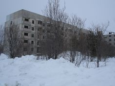 Abandoned apartment blocks near Krasnoyarsk in Siberia, Russia.(photo by Ruth Hetherington)  It's a former Soviet military facility.     Submission by parisinthesummer.