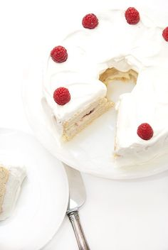 This raspberry white chocolate angel food cake has a very moist texture and the most delicious filling you will ever taste!