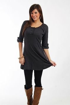"The Daisy Tunic, Charcoal $37.50  This tunic is amazing! The solid colored piece has tabbed half sleeves, a long hemline that flares slightly at the hips, and double rows of buttons on the bodice. The material is so soft and has great stitching details sporadically!   Fits true to size. Miranda is wearing a small.   From shoulder to hem:  Small - 30""  Medium - 30.5""  Large - 31"""