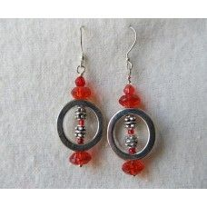 """""""Circle of Silver"""": Silver circles, colorful center, accented with silver and red crystal beads   Silver earwires, 2 1/4 inches long.   Available in multiple colors   $35"""