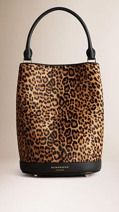 Burberry Camel The Bucket Bag in Animal Print Calfskin - The Bucket Bag in animal print calfskin. Inspired by the runway, the design is made in Italy with hand-finished details. A detachable matching wristlet features inside. Discover the women's bags collection at Burberry.com