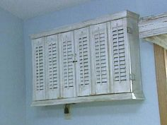 This ideas would work well outside for a wall unit as well Old shutters are used to create a box frame to hide the air conditioner in the wall. From the Decorating Cents Archives @ HGTV. Ac Unit Cover, Ac Cover, Old Shutters, Small Shutters, Repurposed Shutters, Repurposed Items, Window Unit, Window Ledge, Window Panes