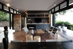 Modern House Design Blending Stone, Steel and Wood into Modernist Box with Glass Walls