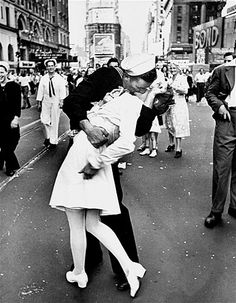 America's jubilation at the announcement of victory over Japan and the end of World War II is reflected in this photo of a US sailor clutching a nurse in a celebratory kiss as thousands gathered in Times Square in New York.